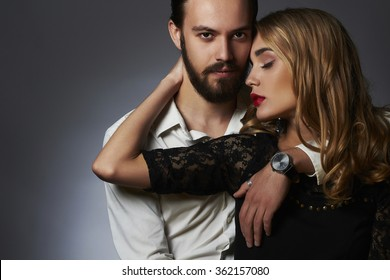 lovely couple in tender passion. Beautiful woman touching the man.beauty girl and boy together