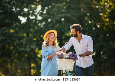 Lovely couple walking through the park