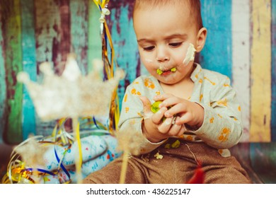 lovely cute boy playing with food