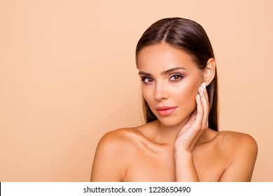 Lovely cute good-looking sweet gorgeous nice stunning adorable lady with naked shoulders she isolated on pastel beige background with copy space for text look at camera touch her cheek by hand