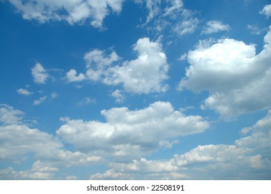 A lovely day with blue sky and light puffy clouds.