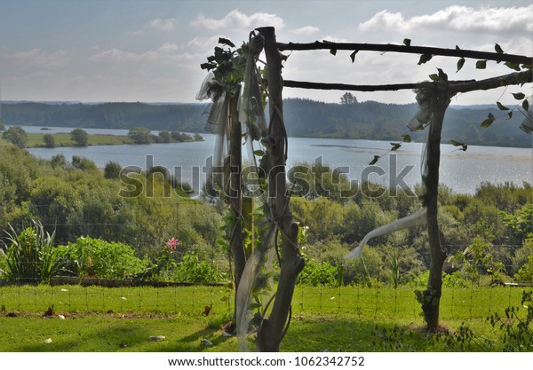 lovely decorated archway for wedding with amazing scenery in background