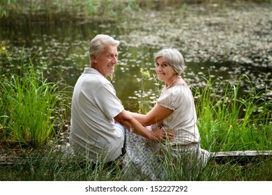 Lovely elderly couple went to the river to relax