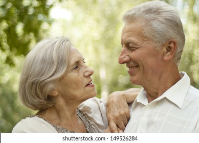 Lovely elderly couple went for a walk in the park on a summer day