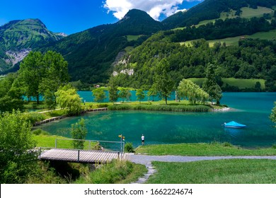 Lovely emerald green lake Lungerersee in Swiss Alps, canton of Obwalden, Switzerland