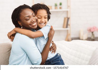 Lovely Family. African mother embracing her daughter, feeling happy and carefree. Copy space