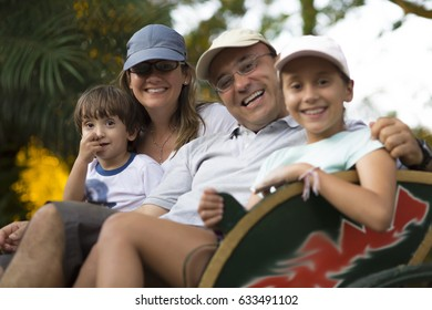 Lovely Family Enjoying Outdoors in Summer