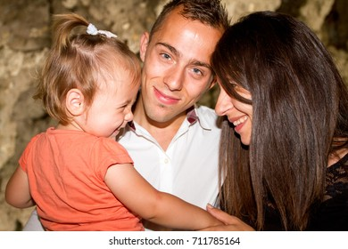 lovely family in fun at park in city summer