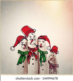 A lovely family hand drawn and finger of snowmen,as concept idea