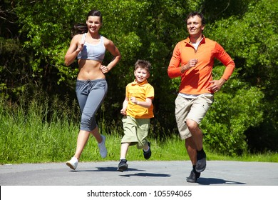 Lovely family jogging in the open air