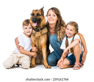 lovely family: mother with two children and their dog isolated on white