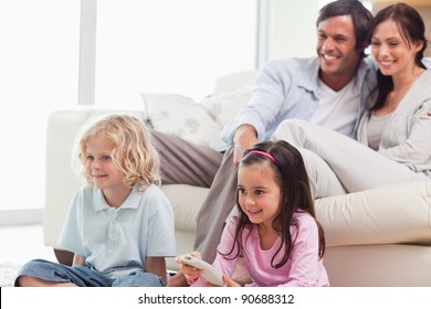 Lovely family watching a movie in a living room