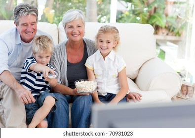 Lovely family watching tv