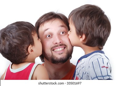 Lovely father is been kissed by his two sons