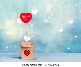 lovely gift box with red heart on blue romantic background