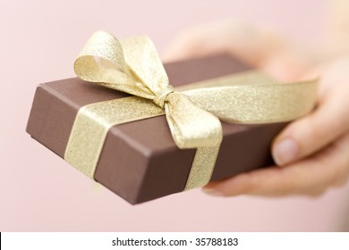 A lovely gift box with woman's hands