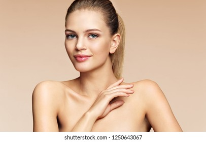Lovely girl with beautiful makeup ion beige background. Beauty & Skin care concept