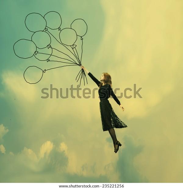 lovely girl in black dress dreams of Ballooning