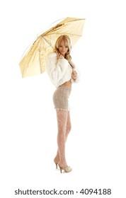 lovely girl with golden umbrella over white