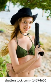 Lovely girl with a gun