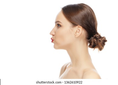 Lovely girl looking away, standing in profile and giving a virtual kiss