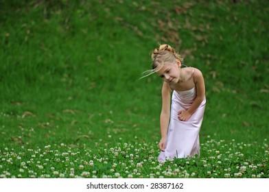 Lovely girl is posing on the grass