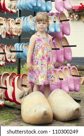 Lovely girl posing in typical dutch huge wooden clogs