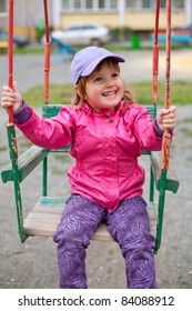 Lovely girl swinging at the schoolyard