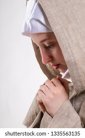 Lovely girl in white scarf and monastic clothes