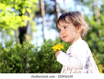 Lovely girl with yellow flower