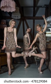 Lovely girls dressed in flapper style outfits have fun, dance and sing