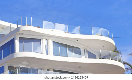Lovely glass balustrades on a curved balcony