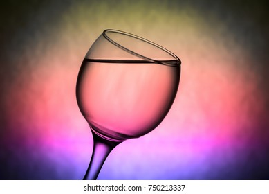 a lovely glass of wine on a colored background