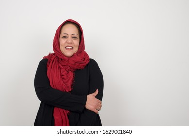 Lovely good-natured Arab woman having charming smile and friendly expression holding herself wanting to show her love and sympathy. My heart is for you!