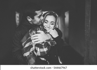 Lovely happy couple.romantic black and white photo.Hugs together and smile