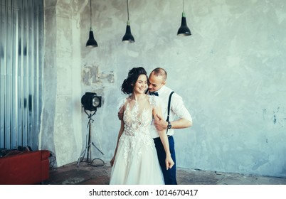 Lovely happy wedding couple. Romantic beautiful woman and handsome man indoor together