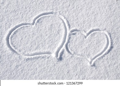 Lovely Hearts Drawn in the Snow in Winter