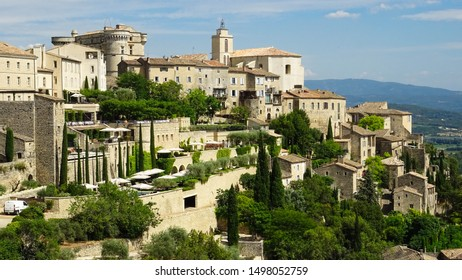 lovely hilltop village Gordes in countryside of Vaucluse departement, Luberon Valley, Provence region in France, Europe, photo taken during sunny summer day, popular place for visitors of Provence