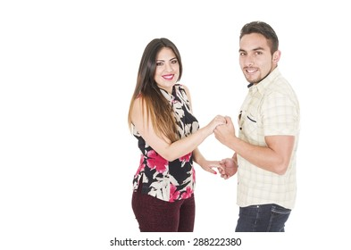 Lovely hispanic couple dancing and smiling at camera