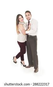 Lovely hispanic couple posing joyfully embracing each other smiling at camera