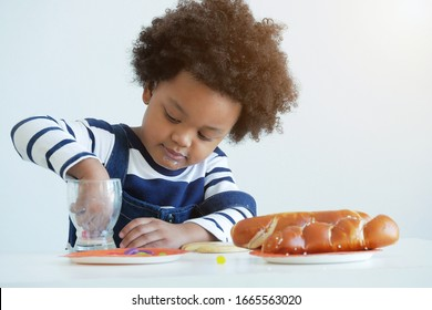 Lovely kid play with kitchen set ,bread and glass of milk.