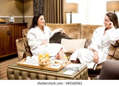 Lovely ladies gossiping in bathrobe