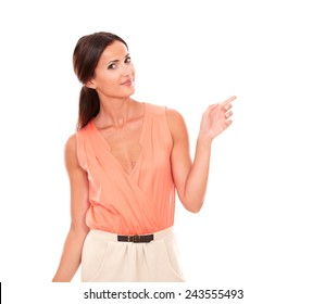 Lovely latin lady with fingers gesturing pointing to her left while looking at you in white background - copyspace