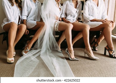 Lovely legs of the bride and her friends