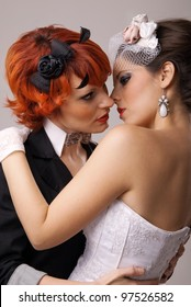 lovely lesbian gay couple just married and kissing