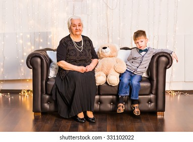 Lovely little boy with his grandmother having fun