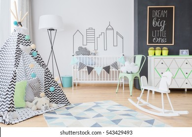 Lovely little boy's room with inspiring toys including wigwam and rocking horse