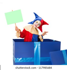 Lovely little clown girl in a blue surprise box with blank sign card