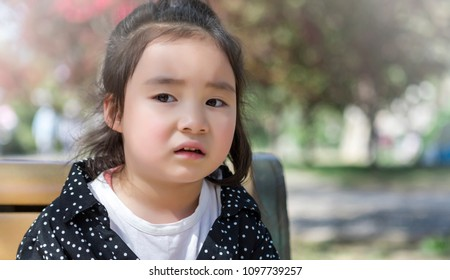 The lovely little girl in Asia is in the park
