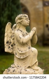 Lovely little stone angel in a medieval French graveyard